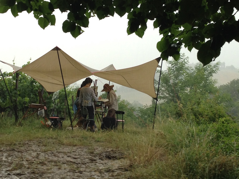 6. Students calmly painting in a rain storm